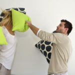 Angry couple pillow fight
