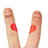 Fingers symbolizing the separation of a couple