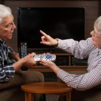 Older couple deciding who gets the remote