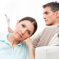 Elderly couple at home giving each other the silent treatment