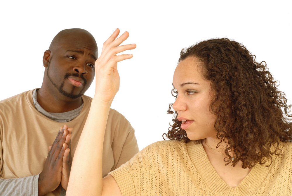 Man begging for forgiveness in an argument with his girlfriend