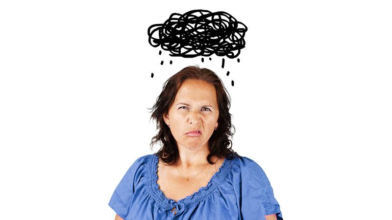 Woman battling dark cloud of despair