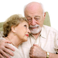 Elderly husband consoling wife