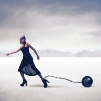 Woman attached to ball and chain