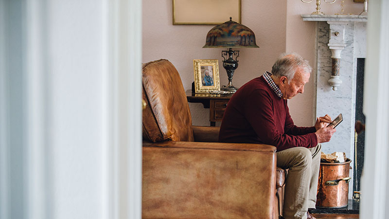 Widower looking at old photos of wife